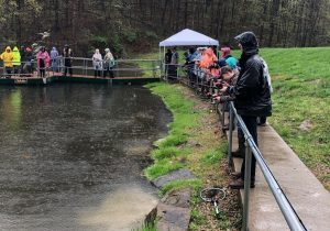Students stocked two lakes in Ohio County with trout on Friday.