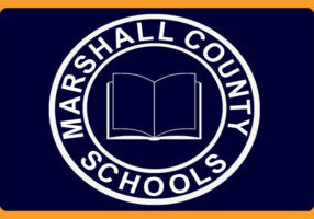 Marshall County Schools logo circle with a book in the middle